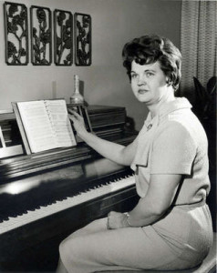 Frances Monson playing the piano.